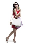 Cheerful young woman shopping with credit card