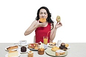 Fashionable young woman eating dessert