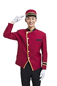 Young bellboy saluting