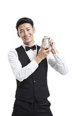 Cheerful young bartender shaking drinks