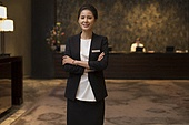 Portrait of confident hotel manager
