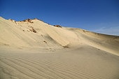 in the middle of the desert rock and track like concept of wild and nature scenic land