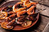 Roasted shrimps and lemon on plate.Seafood, shelfish.BBQ shrimp grilled. Barbecue shrimps or prawns