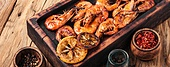 Grilled shrimps on a wooden kitchen board. Delicious seafood.Barbecue srimps prawns. Grilled large prawns