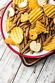Crispy potato chips in bowl.Homemade potato chips. Salty snacks,potato chips