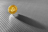 Bitcoin BTC coin shadow on the silver soil. Bitcoin BTC coin shadow on the soil silver background