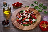 Cheese salad with tomatoes spinach and olives. Cheese salad with tomatoes spinach and kalamata olives