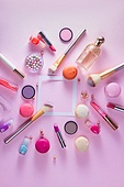 Make up products and macaroons. Make up products and macaroons flat lay frame with copy space on pink background, top view scene