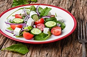 salad with spinach, cheese and tomato. fresh vegetable salad with cucumber,cheese and tomato