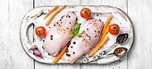 raw chicken on cutting board. Raw chicken meat with spices and tomatoes