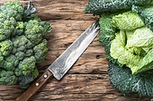 Harvest of rural cabbage. Fresh green cabbage on rustic wooden background