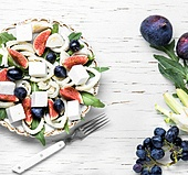 appetizing vegetarian salad with figs, grapes and fennel. vegetarian salad with figs