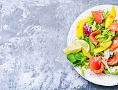 Salad with salmon,mango and fresh herbs. lettuce salad with fish