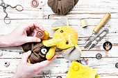 Handmade toy elephant. Process of making a soft elephant toy and working tool