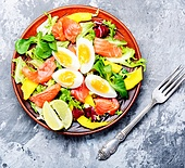 Lettuce salad with salmon. Diet salad with salmon,mango and fresh lettuce