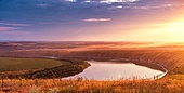Summer panorama of river in canyon. Panoramic view from the hill on bend of the river Dniester at sunset.