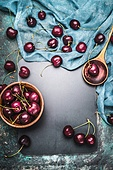 Food background for Cherry berries recipes with cooking spoon and napkin , top view frame