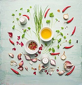 fresh herbs ,spices and cooking oil composing on rustic background, top view