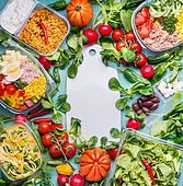 Healthy eating concept with various diet salad lunch boxes and ingredients around white cutting board, top view, frame. Clean organic  food concept
