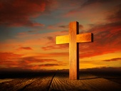 Christian wood cross on sunset sky wooden made