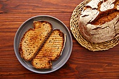 Rye bread toasted slices on dark wooden table top view