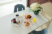 Breakfast with croissant, orange juice and coffee on dinner white table. Breakfast with cereles