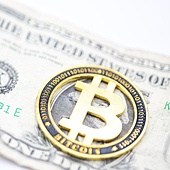 blurred crumpled dollar money and different bitcoin background like concept of problem and future
