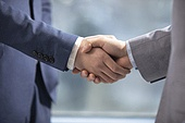 Successful Chinese businessmen shaking hands