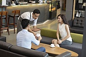 Chinese business people drinking coffee in café