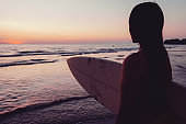 Silhouette of beautiful sexy surfer female