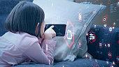 Little girl using a smart phone. Communication network.