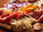 A Beautifully Arranged Delicious, Colorful, Charcuterie And Cheese Board