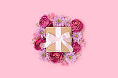 Gift box with a tied ribbon bow and flower frame.