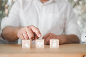 Man hand touch wooden block of icon healthcare medical. The concept of insurance for your health