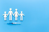 Vaccination concept with family shape. Vaccine vial dose in syringe