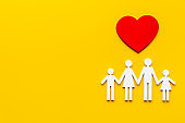 Family wooden figure and heart shape. Life insurance concept