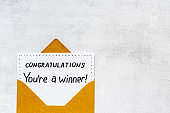 Golden envelope with award card Congratulations You are a winner. Overhead view
