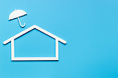 House Insurance, secure and protection concept. House shape under umbrella.