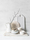 White cottage kitchen decoration. Still life of various white dishes on a white background.