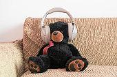 teddy bear in headphones listen to the audio music radio