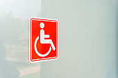 Disabled sign on toilet glass door.