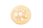 Cosmetic gel or cleansing foam bubbles coral orange gold lotion emulsion cream multi-colored background