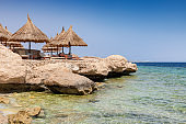 Parasols in Sunny tropical beach resort in Red Sea, Egyp