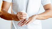 man bodycare male cosmetology applying hand cream