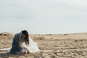female sorrow emotional crisis woman sand desert