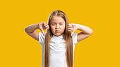 naughty child dislike gesture girl thumbs down