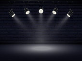 Spotlights with bright white light shining stage. Collections projectors with Illuminated effect . Set of projector for studio with brick wall. Vector illustration