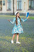 Take your fantasy off the shelf. Happy girl read fantasy book outdoors. Small kid enjoy reading. Fantastic fiction. Fantasy literature. Developing fantasy and imagination. Imaginary world. Fairy tale