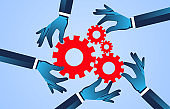Conceptual illustration of team, hands holding gear puzzles together to make the gears work