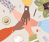 Stack of female hands. Unity and teamwork concept. Arms of successful business women. Partnership community. Top view of workplace. Vector illustration in flat cartoon style